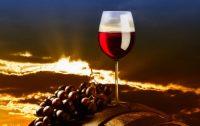 vino_rosso_botte_tramonto.jpg